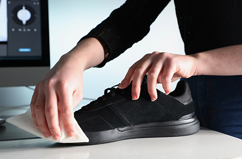 preparing a black shoe for a 360 product photo