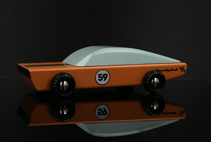 orange toy car - still life product photography